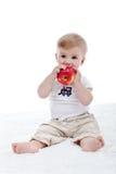 Behandla som ett barn pojken med det stora äpplet Royaltyfri Foto