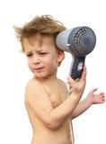Behandla som ett barn pojken med hårtorken över vit Arkivbilder