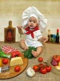 Behandla som ett barn pojken som kläs som en kock Royaltyfri Fotografi