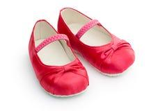 behandla som ett barn röda skor Royaltyfri Foto