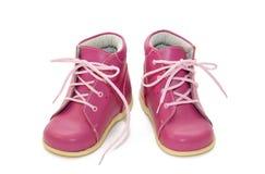 behandla som ett barn rosa skor Royaltyfri Foto