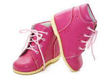 behandla som ett barn rosa skor Arkivbilder