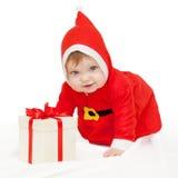 Behandla som ett barn Santa Claus med julgåvan Royaltyfria Foton