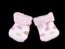 behandla som ett barn svarta rosa sockor Royaltyfria Bilder
