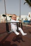 behandla som ett barn swing Arkivbild