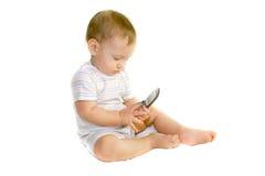 behandla som ett barn telefonen för pojkecellholdingen Royaltyfri Foto