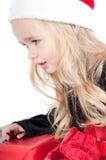 behandla som ett barn upp den christams klädde flickan Royaltyfria Bilder
