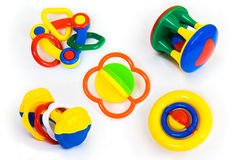 behandla som ett barn vita färgrika isolerade rattles som ställs in Royaltyfria Bilder