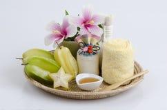 Behandlung mit Sternfrucht und -honig Stockfoto