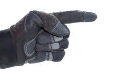 Behandschuhte Hand, die mit dem Finger zeigt Stockfotografie