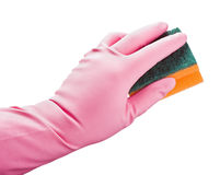 Behandschuhte Hand drückt einen Schwamm für Reinigung zusammen lizenzfreie stockfotografie