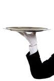Behandschuhte Hand eines Butlers, die ein silbernes Tellersegment anhält lizenzfreie stockfotografie