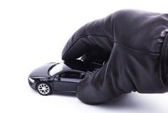 Behandschuhte Hand hält ein Auto Stockbilder