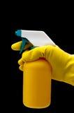 Behandschuhte Handholding-Sprayflasche Stockbilder