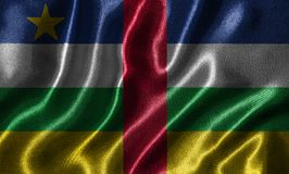 Behang door de vlag van de Centraalafrikaanse Republiek en golvende vlag door FA Royalty-vrije Stock Afbeelding