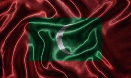Behang door de vlag van de Maldiven en golvende vlag door stof Royalty-vrije Stock Fotografie