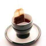 Beharren eines Beutels des Tees Lizenzfreie Stockfotografie