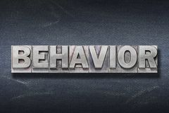 Behavior word den. Behavior word made from metallic letterpress on dark jeans background stock images