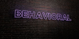 BEHAVIORAL -Realistic Neon Sign on Brick Wall background - 3D rendered royalty free stock image. Can be used for online banner ads and direct mailers stock illustration