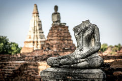 Beheaded Buddha near Wat Chai Watthanaram temple. In Ayutthaya, Thailand Stock Photo