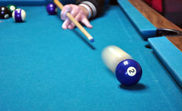 Behind the 2 Ball. A cue ball about ready to strike the 2 ball in billiards stock images