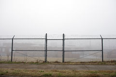 Behind Barbed Wire Royalty Free Stock Image
