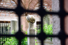 Behind bars Islamic old gravestone in a cemetery Stock Photo