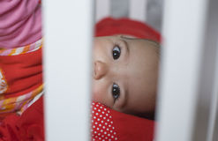 Behind the bars white cot Stock Photos