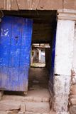 Behind blue door Royalty Free Stock Images