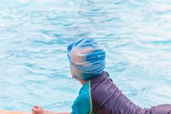 Behind the boys in the pool royalty free stock photography