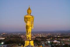 Behind Buddha statue before sunset time at Wat Phra That Kao Noi. Nan, Thailand Stock Photos