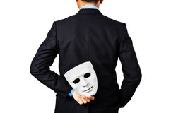 Behind of business man holding white mask. Stock Photos