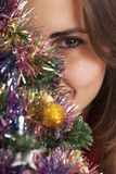 Behind a christmas tree Stock Photo