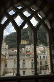 Behind cloisters' portal. Amalfi city view located in the Sorrentine Peninsula. Italy. Amalfi is listed by UNESCO as a World Cultural Heritage site royalty free stock photos