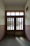 Behind a closed door. Corridor with a closed door stock images