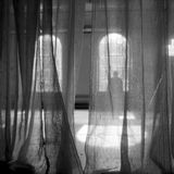 Behind the curtain. Unseen secrets hidden behind the curtain - black and white art concept
