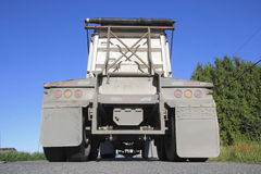 Behind a Dump Truck. Low angle view of the back of a dump truck Royalty Free Stock Photo