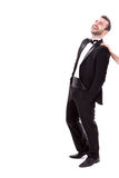 Behind Every Great Man There's a Great Woman. Confident Smart  Looking Man Laughing, Enjoying True Happiness, wearing tuxedo, isolated on white background Stock Photos
