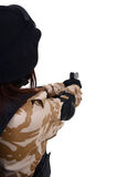 Behind of female soldier with handgun. Royalty Free Stock Image