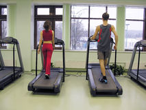 Behind girl and boy in health club Stock Image