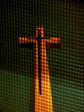 Behind the Glass. A beautiful picture of the holy cross through the textured glass of a window Stock Image