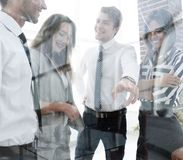 From behind the glass.business team in the officce royalty free stock photos