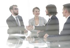 From behind the glass.handshake of business partners Royalty Free Stock Images