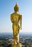Behind the golden Buddha statue Stock Image