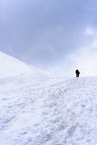 Behind the horizon. Man and woman climbing in the snow Stock Photography