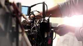 Behind the 4k high defination video camera. Shooting by film crew team in big studio production Royalty Free Stock Photo