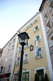 Behind lamp. Old buildings behind streetlamp in Salzburg, Austria Royalty Free Stock Photos