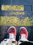 Behind the line and loading sign Royalty Free Stock Photo