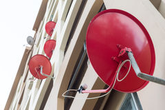 Behind of many satellite dish beside apartment Royalty Free Stock Images