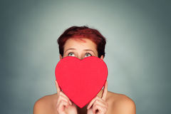 Behind a red heart looking up Stock Photography
